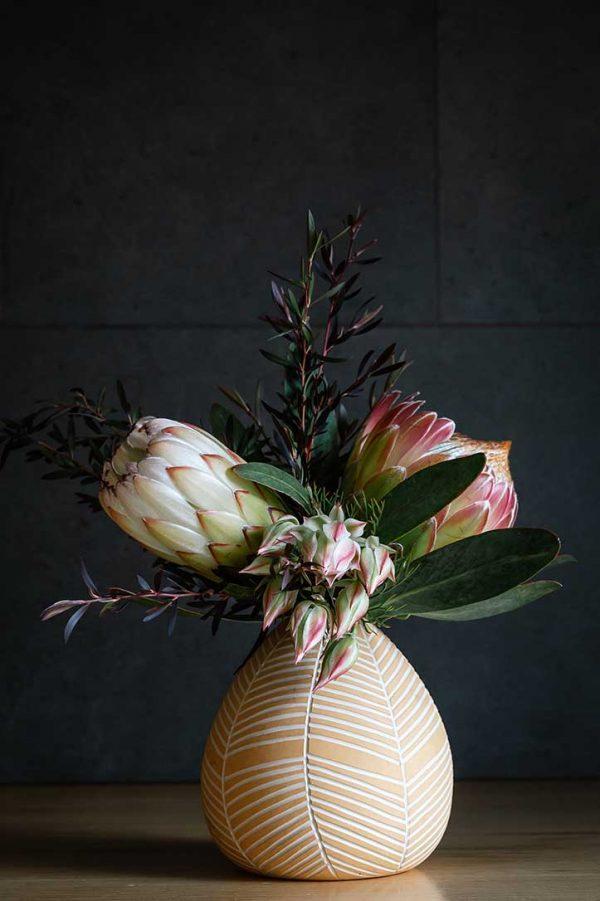 koa vase with natives